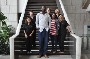 Dikembe Mutombo and his wife Rose pose with the WOGO Pre-Trip team in Kinshasa, Democratic Republic of Congo